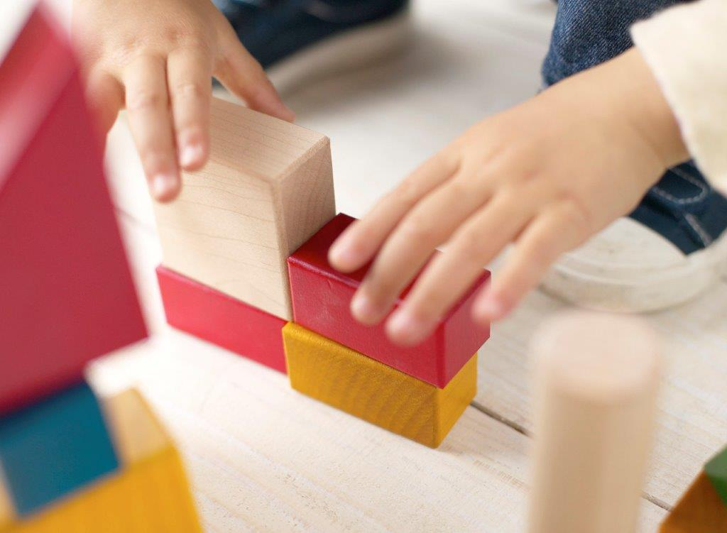Child Stacking Building Blocks Image